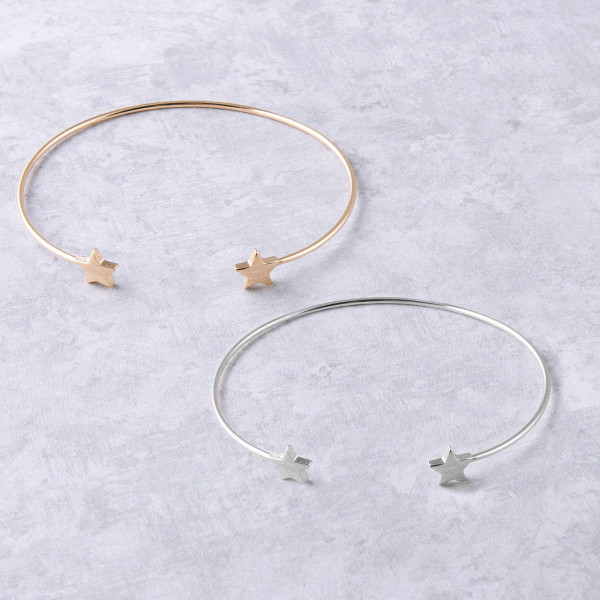 """Dainty metal cuff bracelet featuring star details. Approximately 3"""" in diameter. Fits up to a 6"""" wrist."""