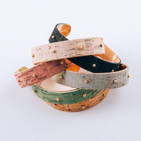 """Cork inspired cuff bracelet featuring gold beaded accents. Approximately 3"""" in diameter. Fits up to a 6"""" wrist."""