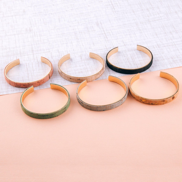 """Metal, cork inspired cuff bracelet. Approximately 3"""" in diameter. Fits up to a 6"""" wrist."""