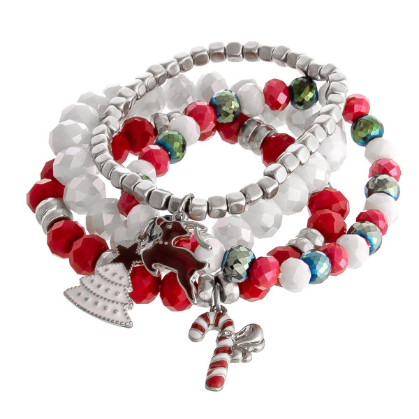 """Enamel coated Christmas charm beaded stretch bracelet set of four. Approximately 3"""" in diameter unstretched. Fits up to a 6"""" wrist."""