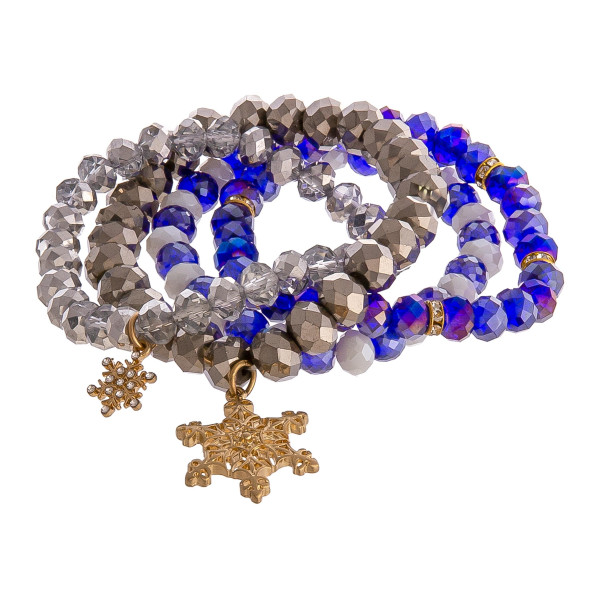 "Beaded Christmas snowflake charm stretch bracelet set. Approximately 3"" in diameter unstretched. Fits up to a 6"" wrist."