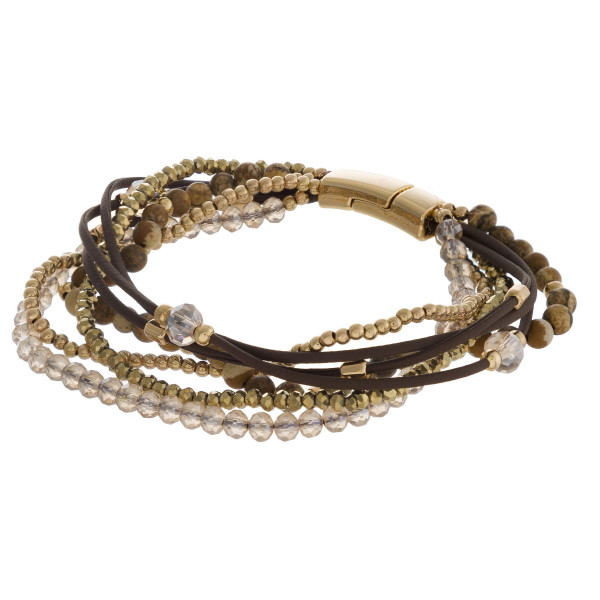 """Multi-stand cord natural stone beaded bracelet with magnetic closure. Approximately 3"""" in diameter. Fits up to a 6"""" wrist."""