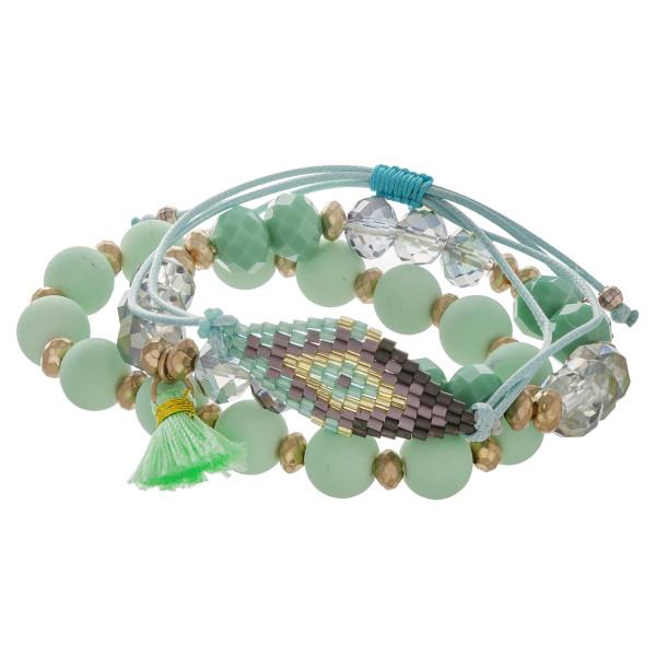 "Semi precious beaded stretch bracelet set featuring a boho style cord bracelet with native and tassel details. Approximately 3"" in diameter. Fits up to a 6"" wrist."