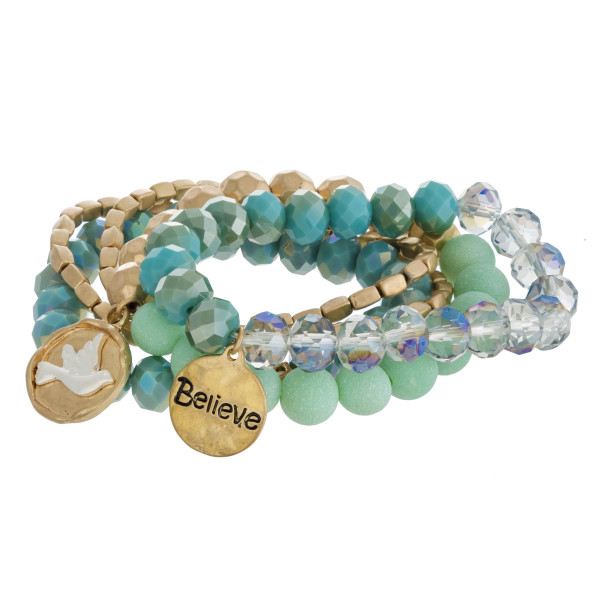 "Semi precious beaded charm stretch bracelet set featuring ""Believe"" engraved details. Approximately 3"" in diameter unstretched. Fits up to a 6"" wrist."