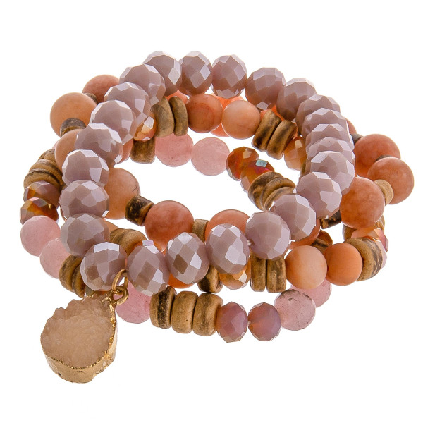 "Natural stone beaded stretch bracelet set featuring a druzy teardrop charm with wood and faceted bead details. Approximately 3"" in diameter unstretched. Fits up to a 6"" wrist."