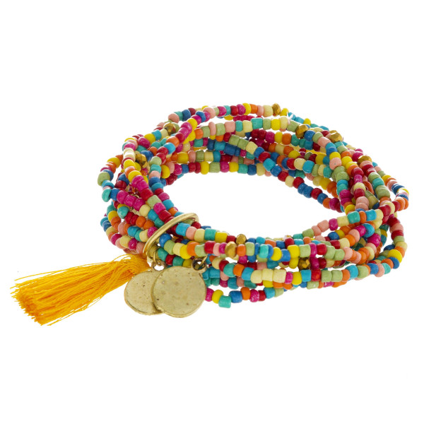 "Boho beaded stretch bracelet set featuring ten beaded strands with a tassel detail and gold metal accents. Approximately 3"" in diameter unstretched. Fits up to a 6"" wrist."