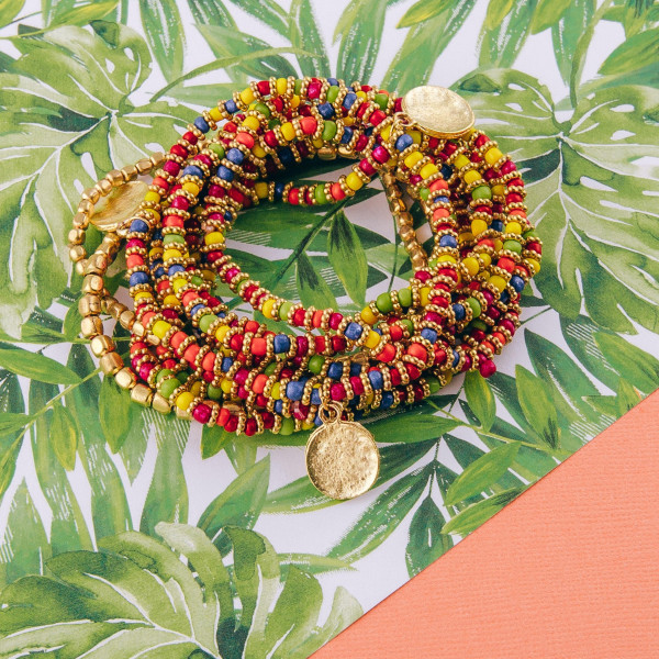 "Beaded boho stretch bracelet featuring multicolor bead details with gold metal accents. Approximately 3"" in diameter unstretched. Fits up to a 6"" wrist."