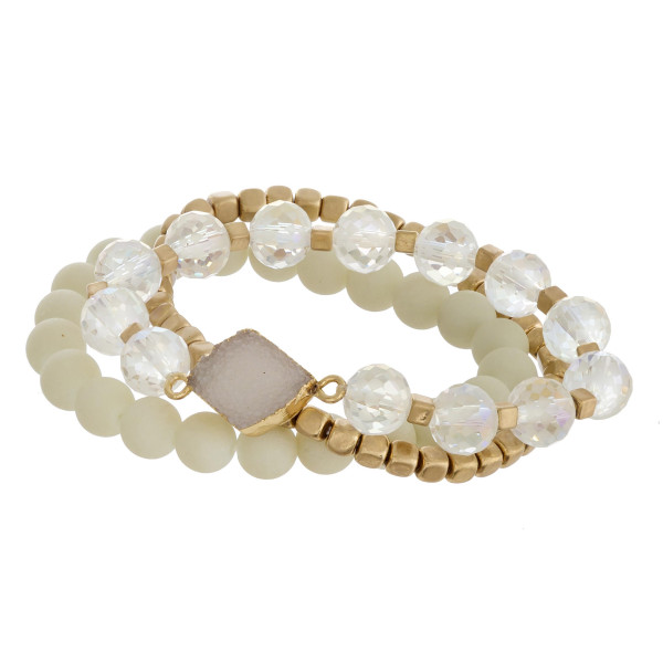 "Semi precious beaded stretch bracelet set featuring a druzy focal with acrylic and gold block bead details. Approximately 3"" in diameter. Fits up to a 6"" wrist."