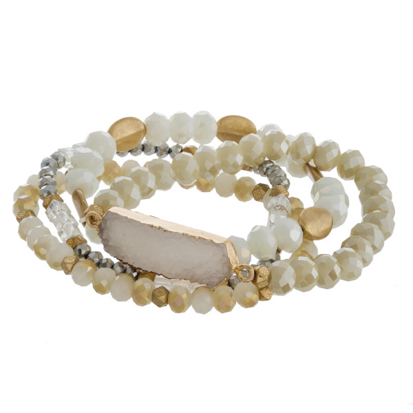 "Semi precious beaded stretch bracelet featuring a druxy bar focal with faceted and gold bead details. Approximately 3"" in diameter. Fits up to a 6"" wrist."