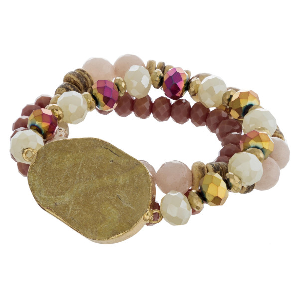 "Beaded stretch bracelet set featuring a natural stone focal with wood and faceted bead details. Approximately 3"" in diameter unstretched. Fits up to a 6"" wrist."