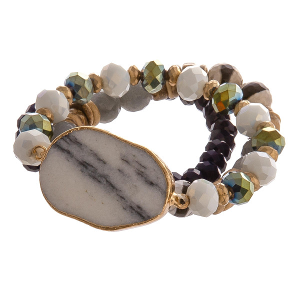 """Beaded stretch bracelet set featuring a natural stone focal with wood and faceted bead details. Approximately 3"""" in diameter unstretched. Fits up to a 6"""" wrist."""