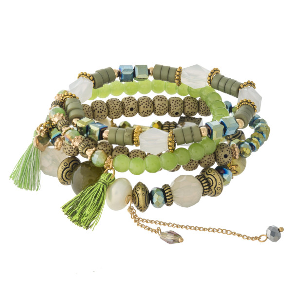 "Natural stone, iridescent and faceted beaded stretch bracelet set featuring lava and plastic bead details with tassel accents. Approximately 3"" in diameter unstretched. Fits up to a 6"" wrist."