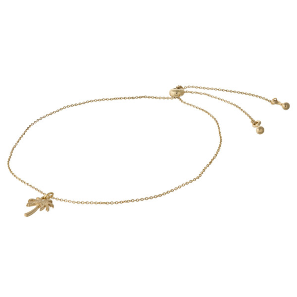 """Dainty cable chain anklet featuring a palm tree charm with an adjustable slider closure. Fits up to an 8"""" ankle."""