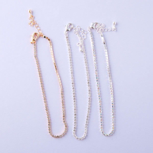 "Anklet set featuring three anklets with cubic zirconia details. Approximately 4"" in diameter. Fits up to an 8"" ankle."