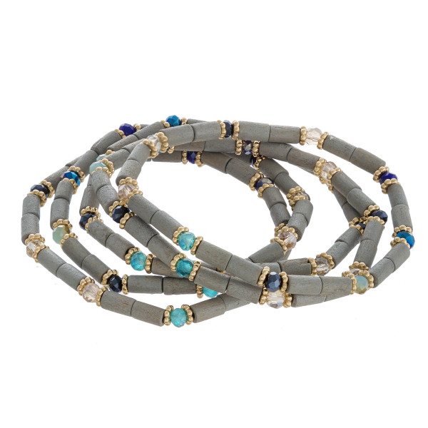 "Wood beaded stretch bracelet set featuring faceted bead details with gold accents. Approximately 3"" in diameter unstretched. Fits up to a 6"" wrist."