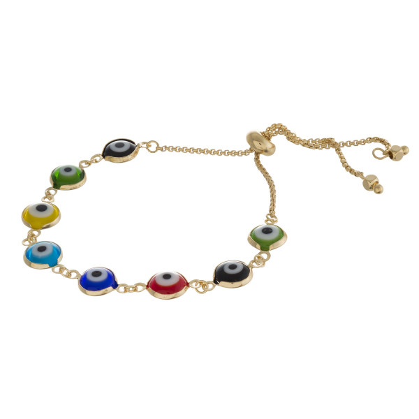 "Metal bolo bracelet featuring traditional good luck and Evil Eye accents. Approximately 3"" in diameter. Fits up to a 6"" wrist."