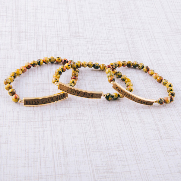 """Natural stone beaded stretch bracelet featuring a faux leather focal with """"John 3:16"""" engraved details. Approximately 3"""" in diameter unstretched. Fits up to a 6"""" wrist."""
