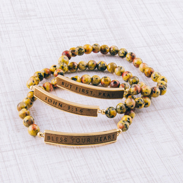 """Natural stone beaded stretch bracelet featuring a faux leather focal with """"Bless Your Heart"""" engraved details. Approximately 3"""" in diameter unstretched. Fits up to a 6"""" wrist."""