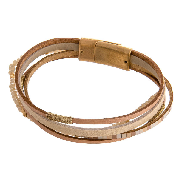 """Multi strand faux leather bracelet featuring iridescent beaded details with wire wrapped accents and magnetic closure. Approximately 3"""" in diameter. Fits up to a 6"""" wrist."""