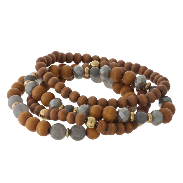 """Wood beaded stretch bracelet set featuring faceted and acrylic bead details with gold accents. Approximately 3"""" in diameter unstretched. Fits up to a 6"""" wrist."""