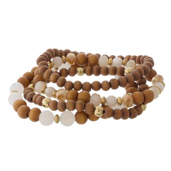"Wood beaded stretch bracelet set featuring faceted and acrylic bead details with gold accents. Approximately 3"" in diameter unstretched. Fits up to a 6"" wrist."
