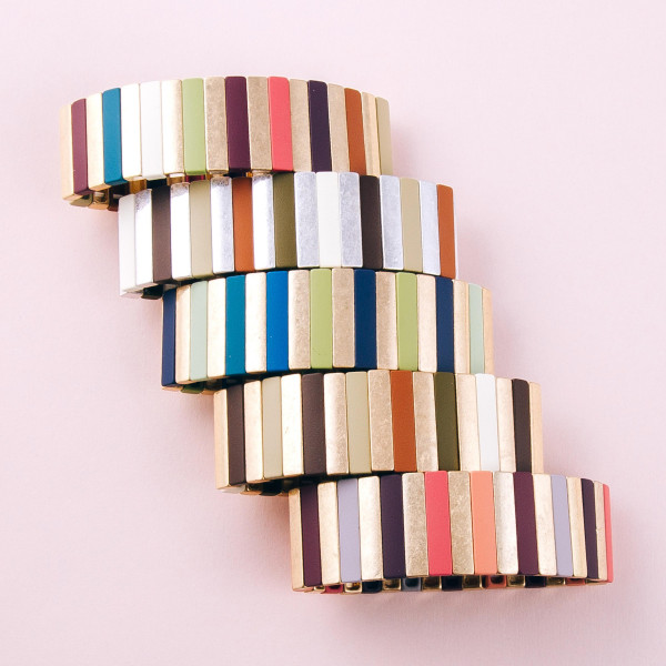 """Metal tone color block pinstripe stretch bracelet. Approximately 3"""" in diameter unstretched. Fits up to a 6"""" wrist."""