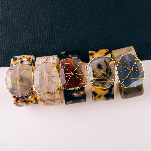 """Resin cuff bracelet featuring a quartz inspired stone with wire wrapped details. Approximately 3"""" in diameter. Fits up to a 6"""" wrist."""