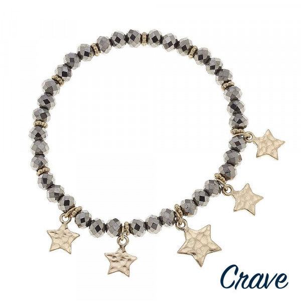 """Faceted beaded stretch bracelet featuring star accents. Approximately 3"""" in diameter unstretched. Fits up to a 6"""" wrist."""