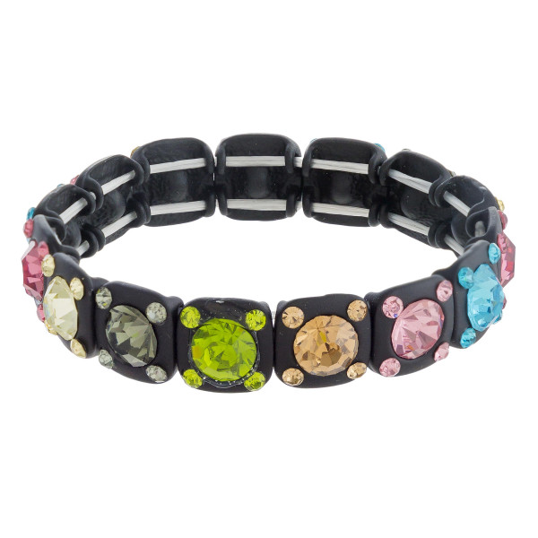 """Multicolor rhinestone block stretch bracelet. Approximately 3"""" in diameter unstretched. Fits up to a 6"""" wrist."""