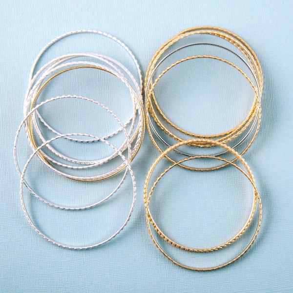 "Two tone metal bangle bracelet set. Approximately 3"" in diameter."