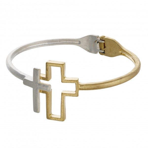 "Hinged bangle bracelet featuring a double cross focal. Approximately 3"" in diameter."