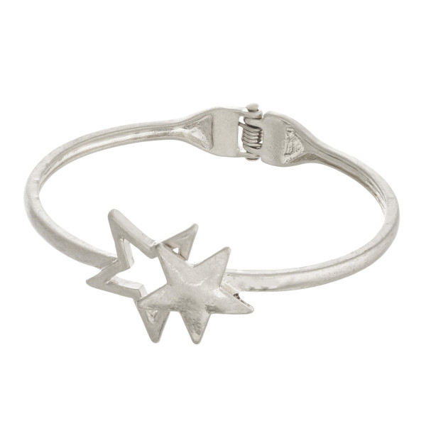 "Silver hinged bangle bracelet featuring a star focal. Approximately 3"" in diameter. Fits up to a 6"" wrist."