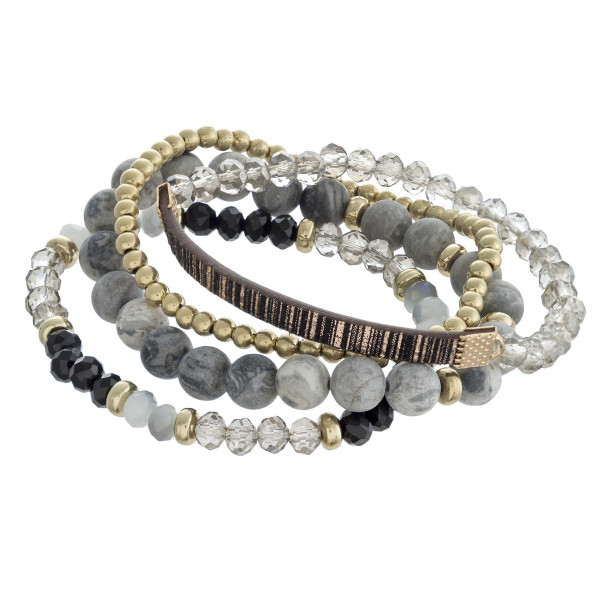 """Multi strand natural stone beaded stretch bracelet set featuring faceted bead and faux leather details. Approximately 3"""" in diameter unstretched. Fits up to a 6"""" wrist."""