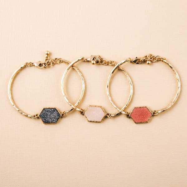 """Metal bangle bracelet featuring a druzy focal. Approximately 3"""" in diameter. Fits up to a 6"""" wrist."""
