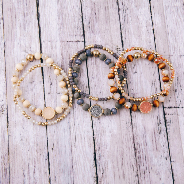 "Beaded stretch bracelet set featuring wood and faceted bead details with a druzy accent. Approximately 3"" in diameter unstretched."