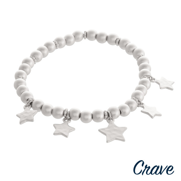 """Beaded stretch bracelet featuring star accents. Approximately 3"""" in diameter unstretched. Fits up to a 6"""" wrist."""