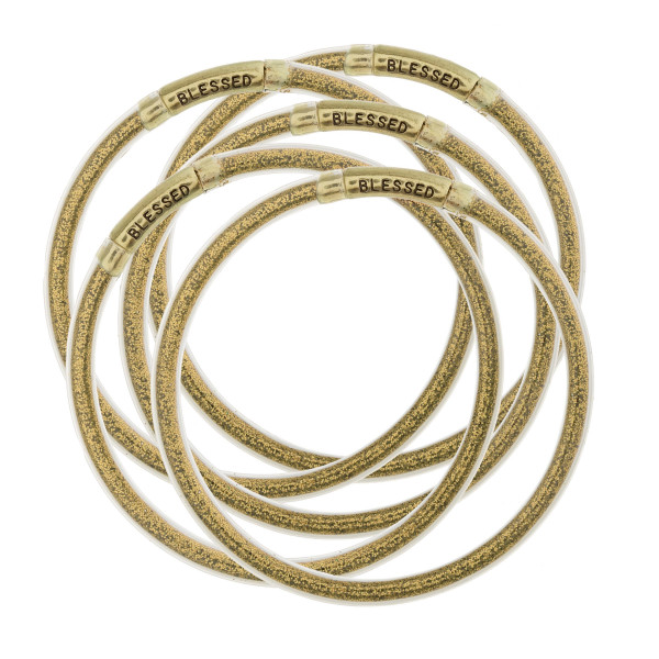 """Glitter jelly bangle bracelet set of five featuring """"Blessed"""" engraved details. They're popularly known as """"Blessed Bangles"""". Approximately 3"""" in diameter. Fits up to a 6"""" wrist."""