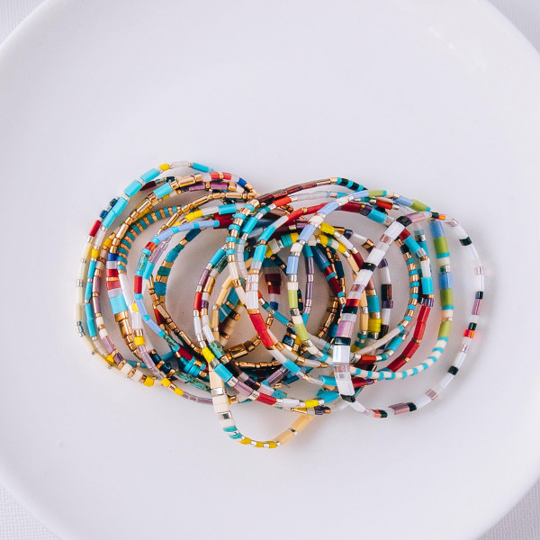 "Multicolored Miyuki Tila bead stretch bracelet. Approximately 3"" in diameter. Fits up to a 6"" wrist."