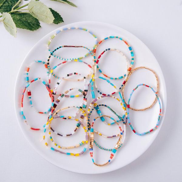 "Multicolored Miyuki Tila bead stretch bracelet. Approximately 3"" in diameter. Fits up to a 6"" wrist."
