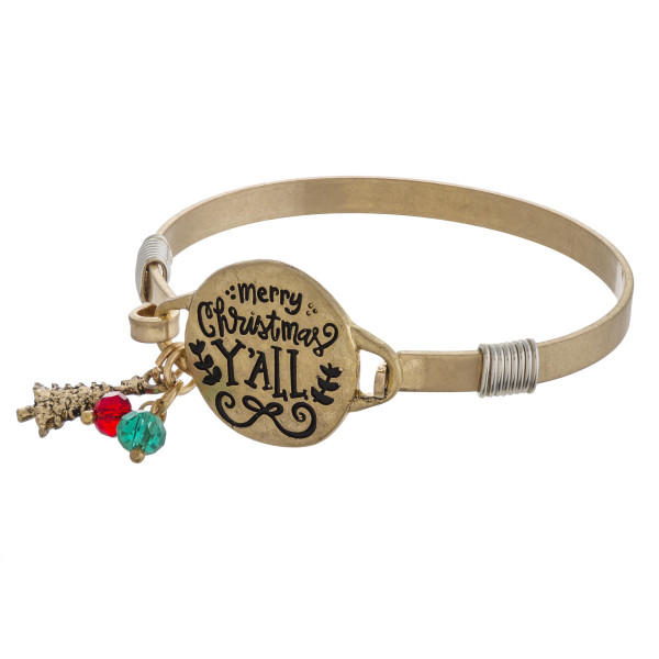 """""""Merry Christmas Y'all"""" engraved bangle charm bracelet. Approximately 2.5"""" in diameter. Fits up to a 5"""" wrist."""