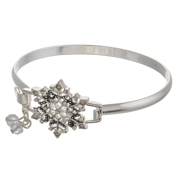 """Christmas snowflake bangle bracelet with rhinestone accents. Approximately 2.5"""" in diameter. Fits up to a 5"""" wrist."""