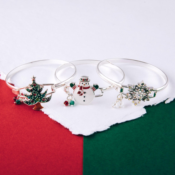 """Enamel coated snowman bangle bracelet. Approximately 2.5"""" in diameter. Fits up to a 5"""" wrist."""