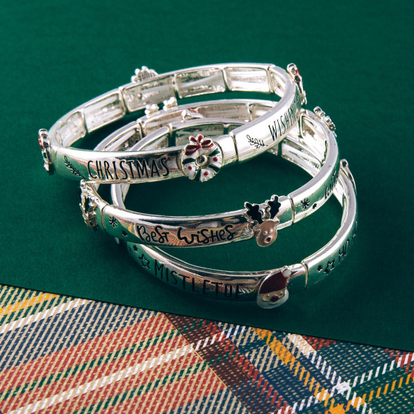 """""""Merry Christmas"""" engraved stretch bracelet featuring an enamel coated accent. Approximately 2.5"""" in diameter unstretched. Fits up to a 5"""" wrist."""