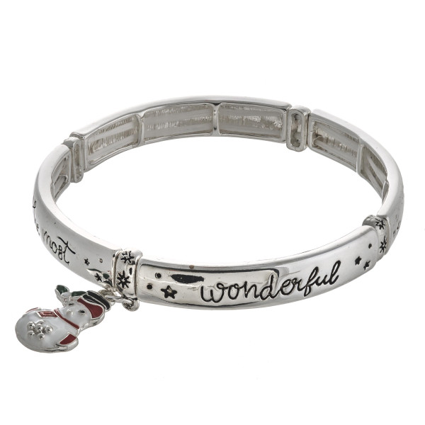 """""""It's the most wonderful time of the year"""" engraved stretch bracelet with enamel coated charm. Approximately 2.5"""" in diameter unstretched. Fits up to a 5"""" wrist."""