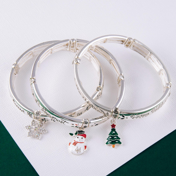 """""""Let it Snow"""" engraved stretch bracelet with enamel coated charm. Approximately 2.5"""" in diameter unstretched. Fits up to a 5"""" wrist."""