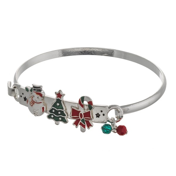 """Enamel coated Christmas assorted bangle bracelet. Approximately 2.5"""" in diameter. Fits up to a 5"""" wrist."""