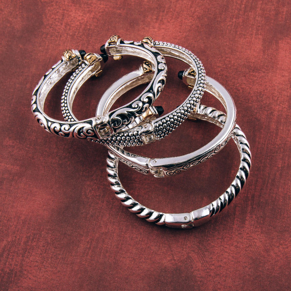 "Two tone filigree hinge cuff bracelet. Approximately 2.5"" in diameter. Fits up to a 5"" wrist."