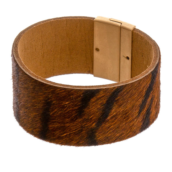 """Fur genuine leather animal print magnetic bracelet. Approximately 3"""" in diameter, 1.25"""" in width. Fits up to a 6"""" wrist."""
