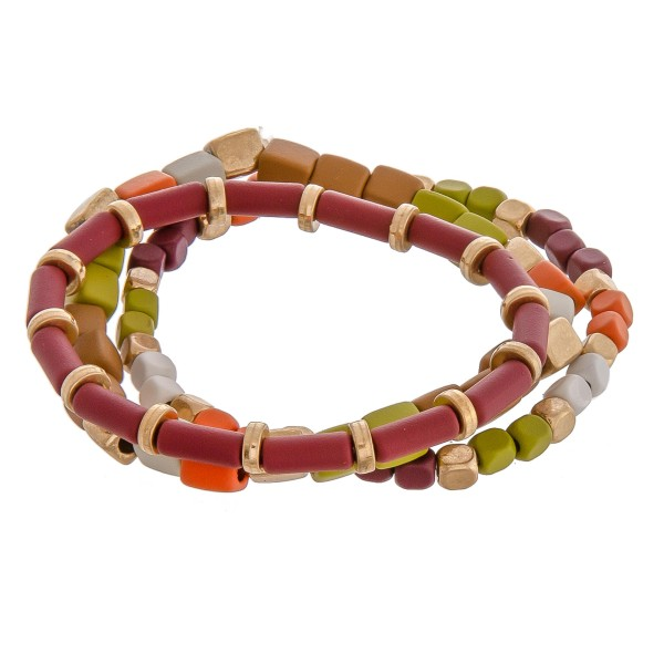 """Coated color block beaded stretch bracelet set of three.   - Approximately 3"""" in diameter unstretched - Fits up to a 6"""" wrist"""