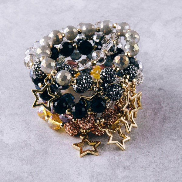 "Beaded star stretch bracelet featuring rhinestone accents. Approximately 3"" in diameter unstretched. Fits up to a 6"" wrist."